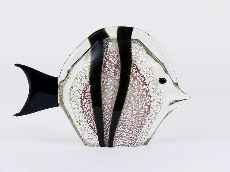 A beautiful handblown fish sculpture by Mario Badioli from the 1970s. Made of clear, black and purple Murano glass with silver flakes. In excellent condition, signed on its underneath.