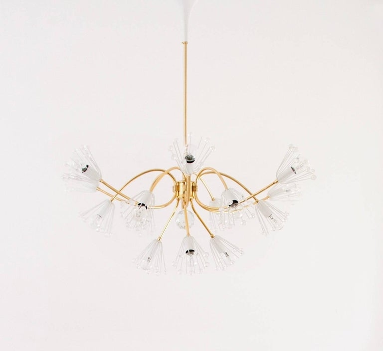 A lovely Austrian midcentury brass chandelier with six plus three arms, this is the large model with a diameter of 32 in, designed by Emil Stejnar, executed by Rupert Nikoll in the 1950s. The chandelier 15-light sources. Professionally restored. In