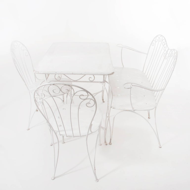 A charming and elegant set of wire garden furniture, a seating group designed and executed by Stanislaus Karasek & Co in the 1950s in Austria. The set is made of white lacquered metal and consists of a square table, a bench and two chairs. To be