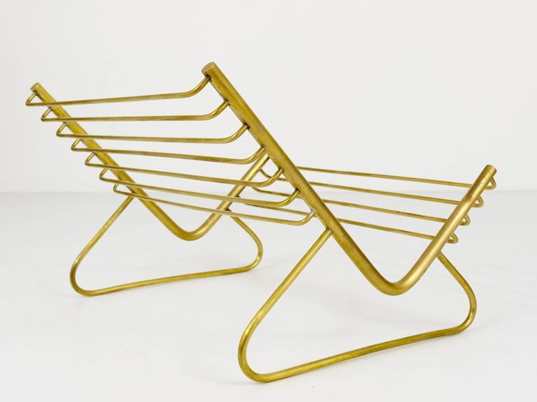 A beautiful modernist brass book stand, designed and executed by Carl Aubock, Austria, 1950s. In excellent condition.