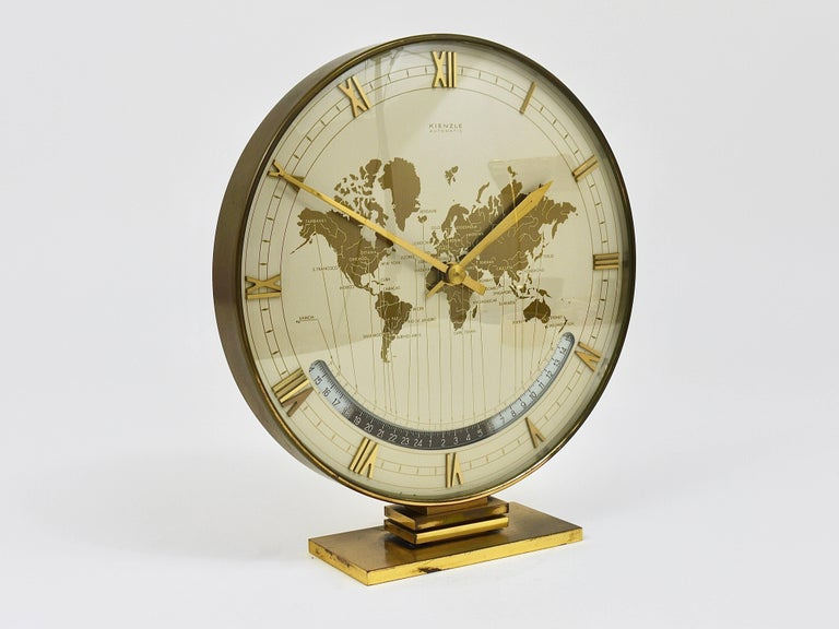 Large midcentury kienzle gmt world time zone brass table clock an impressive and large brass and glass modernist desk or table clock with a world map gumiabroncs Image collections
