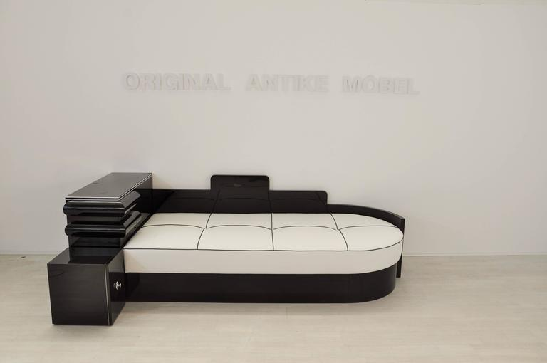 Wonderful french daybed. It offers a simple yet detailed design wich is typical for the Art Deco era. With its new 20cm cold foam mattress it is suitable for sleeping on it. Also you will find a small storage compartment on the side with a chromed