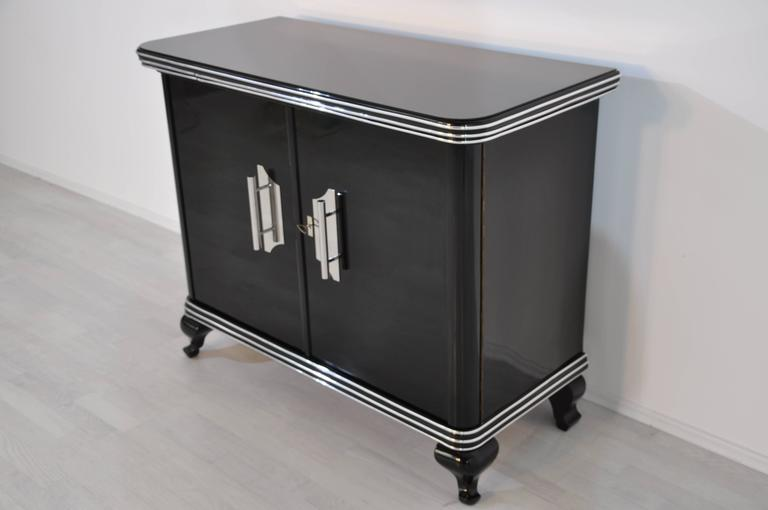 Petite Art Deco commode with a beautiful design. Classic Art Deco in its purest form! It offers wonderfully carved feet and small expandable serving plate.