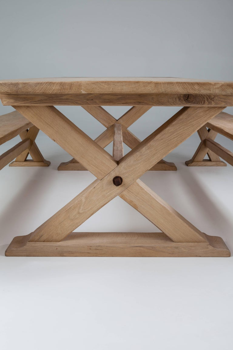 Rectangular, on a cross frame support with exposed bolts in Arts & Crafts style. Available in a range of natural and stained wood finishes. Made up to 400 cm long. 250 cm table £4250; 300 cm table £4,950; 350 cm table £5,750; 400 cm table £5,950;
