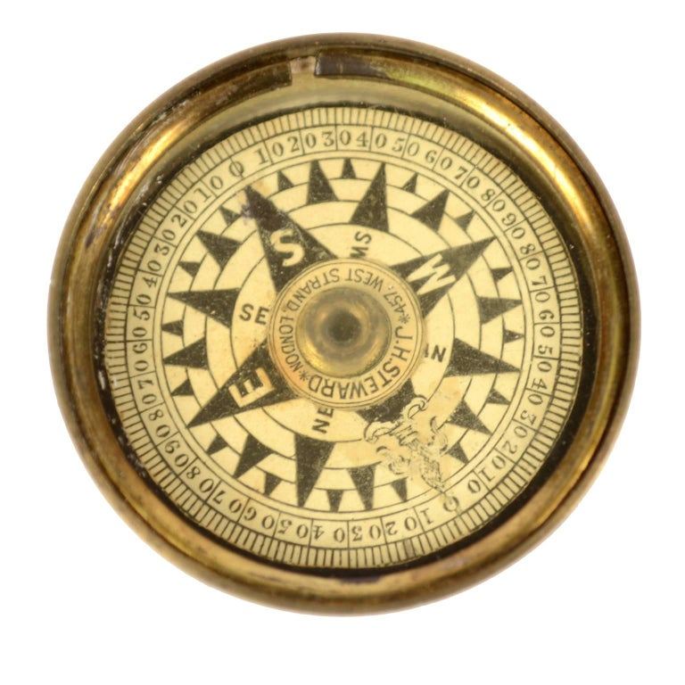 Dry compass placed in its original box made of turned brass, complete with cover and closed by a protective glass. Signed J.H Steward, 457 West Strand London made in the second half of the 19th century. Eight-wind compass card printed on paper by