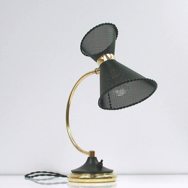 Very rare Mathieu Matégot attributed table lamp, made in France in the 1950s.