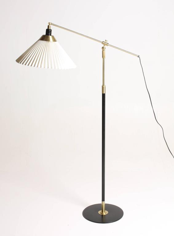 Metal Pair of Adjustable Floor Lamps by Le Klint For Sale