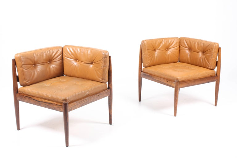 Great looking sofa / easy chairs with ottoman made in solid rosewood with seats and back in patinated leather. Designed by Maa. Kai Kristensen for Magnus Olesen cabinet makers in the 1960s. Great original condition.