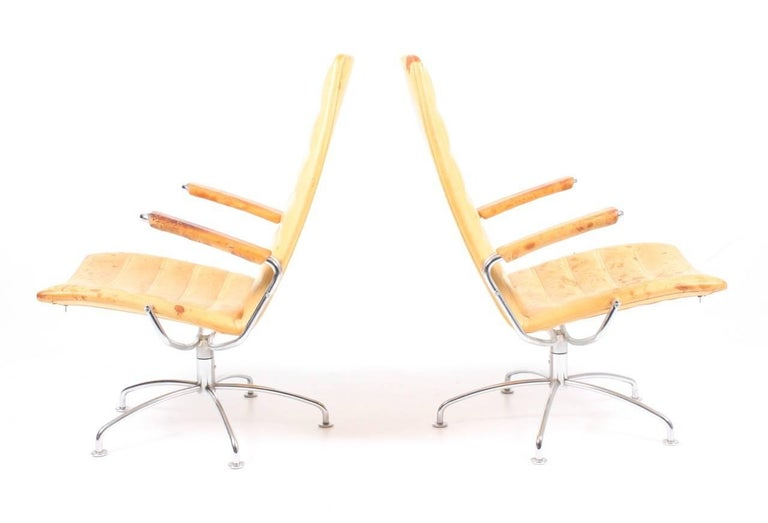 Pair of lounge chairs in original patinated leather and chromed steel. Designed by Jens Amundsen for Fritz Hansen Denmark in 1989.
