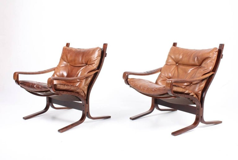 Pair of great looking lounge chairs in plywood and patinated leather designed by Ingmar Relling in 1965. Made in Norway. All original condition.