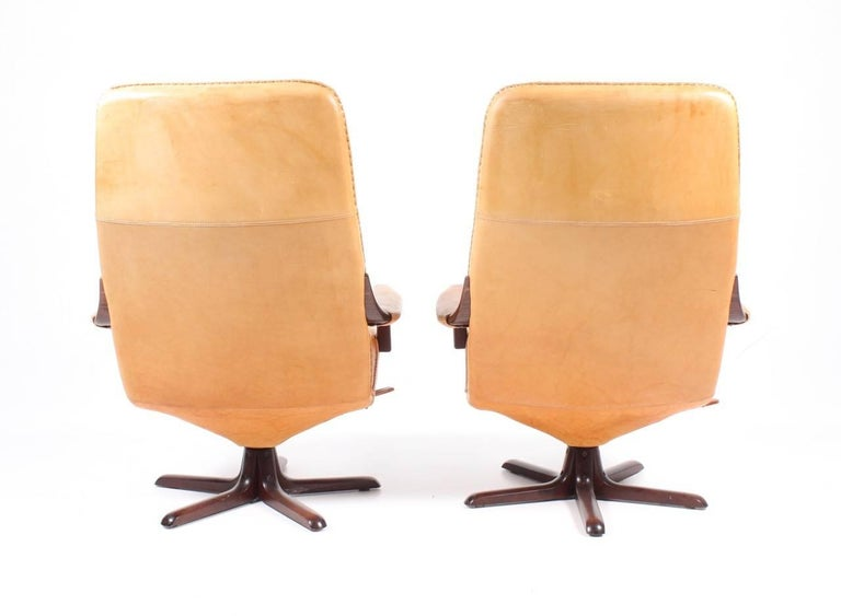 Norwegian Pair of Recliners in Patinated Leather Model Berg C90 For Sale