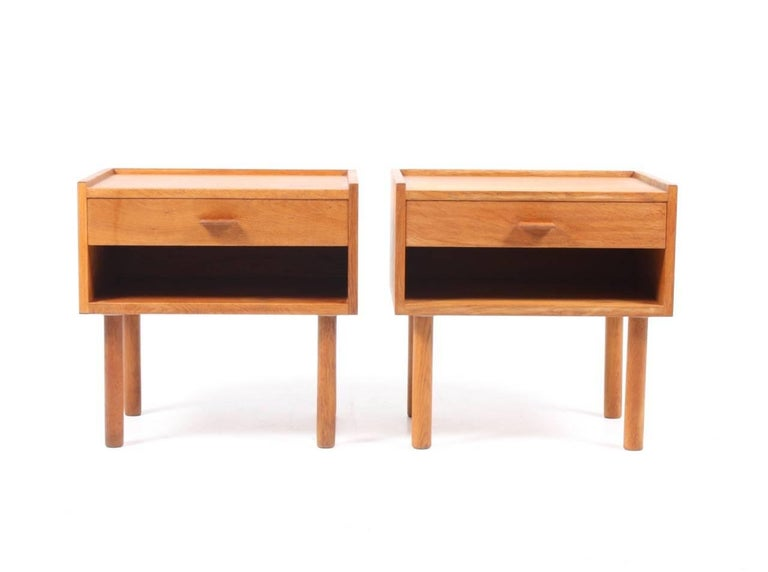 Pair of great looking nightstands in well patinated Scandinavian oak designed by Maa. Hans Wegner. Made by RY furniture Denmark in the 1960s. Very nice condition.