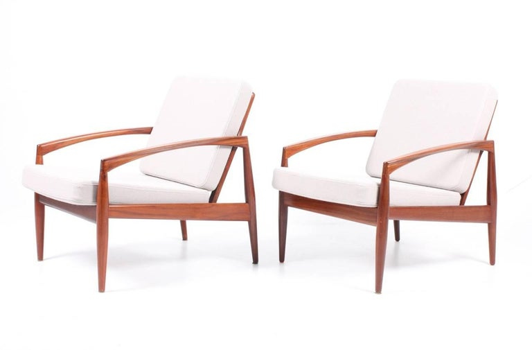 Pair of lounge chairs model paper knife in rosewood, upholstered with new fabric.
