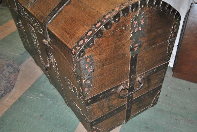This is a Sea chest made in England, circa 1700. It is made of solid oak with hand-forged iron work throughout the entire chest. The beauty and quality of the iron work is amazing and as good as it can get. The chest is finished on the back so it is