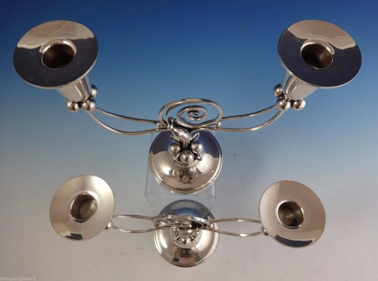 Blossom by Boardman.  Modernist sterling silver pair of candelabras made by Boardman of Hartford, CT, circa 1940s. They feature a Danish-modern style with blossoms and 3-D balls. The candelabras each hold two candles. The piece is marked with