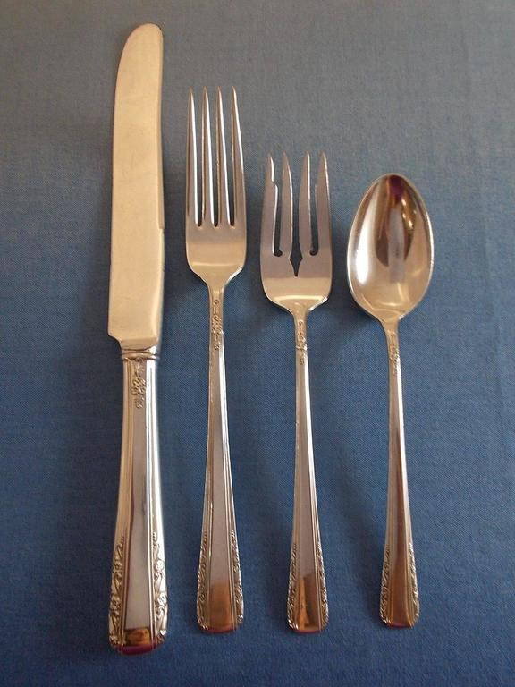 Courtship by international sterling silver flatware set of 35 pieces. This set includes:  8 KNIVES, 9 1/8