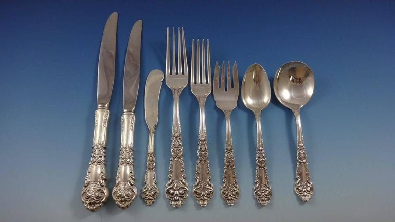 Inspired by the French Renaissance with its ornate scrolls and intricate design, this beautiful pattern was introduced by Reed & Barton in the year 1941.  French Renaissance by Reed & Barton sterling silver huge dinner and luncheon flatware set of