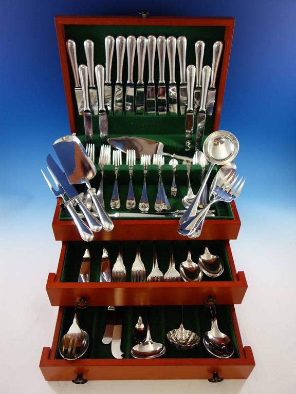 Large dinner size Fidelio by Christofle France silver plate flatware set of 112 pieces. This set includes: eight dinner size knives, 9 1/2