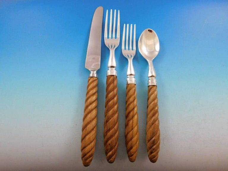 Exquisite Kent by Oscar de la Renta Silverplate & twisted Teak handle Flatware set, 70 pieces. This set includes: 14 Dinner Knives, 9 1/2