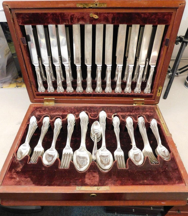 Outstanding dinner and luncheon size Lancaster Rose by Gorham Sterling silver flatware set in original fitted chest, 102 pieces. This set includes: