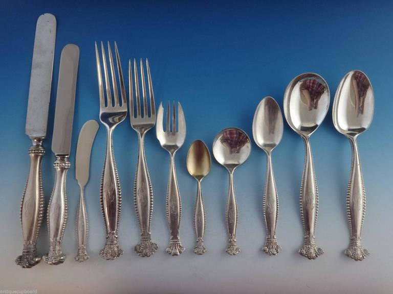 Sandringham by Shieblersterling silver flatware set in original fitted box, circa 1890s. This fabulous regal set includes:  12 dinner size knives, 10 1/8