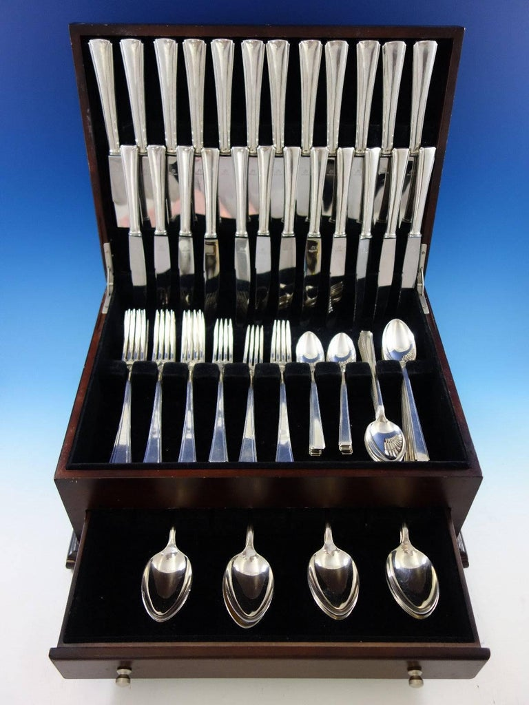 Dinner size (post 1933) Yugoslavia 800 silver flatware set - 84 pieces. Note - the teaspoons and place spoons in this set are Modern Classic by Lunt sterling silver. This set includes:  12 dinner size knives, 8 7/8