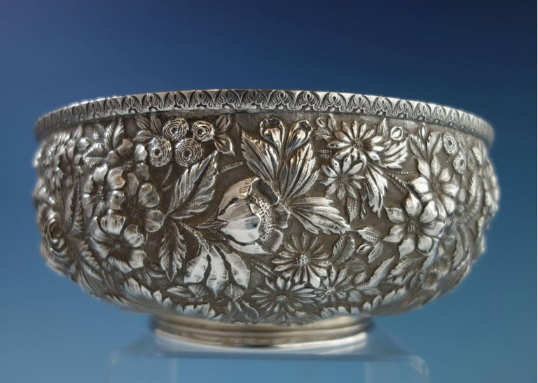 """Repousse by Jenkins & Jenkins sterling silver footed fruit bowl. It is marked #188 and retailed by J.E. Caldwell. This piece weighs 19.7 troy ounces and measures 4 1/4"""" x 8 1/4"""" diameter. It is monogrammed on the underside (see photo),"""