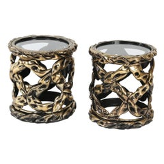 """Pair of 1970s """"Ribbon"""" side tables with gold/brass tones and circular glass tops"""