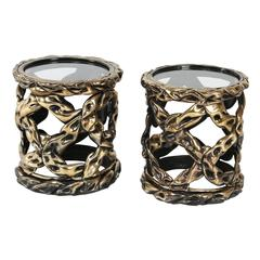 "Pair of ""Ribbon"" side tables with gold/brass tones and circular glass top"
