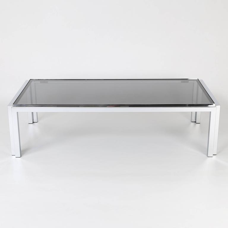 """Large and sleek rectangular cocktail table features a square tubular chrome frame that supports an inset 3/8""""-thick gray-smoked-glass top.   See this item in our Brooklyn showroom, 61 Greenpoint Ave., Suite 312, Brooklyn, 11 a.m. to 5 p.m."""