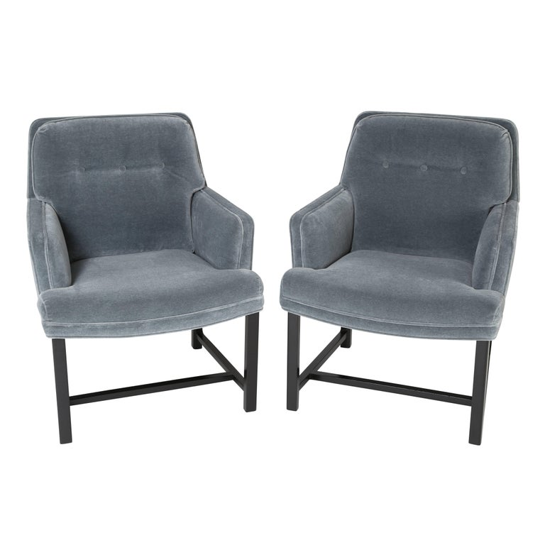 This fine pair of armchairs designed by Edward Wormley reflects Dunbar's signature high-quality construction. Sturdy and versatile, these chairs have been professionally refinished and newly reupholstered in a grey-blue mohair velvet. 28