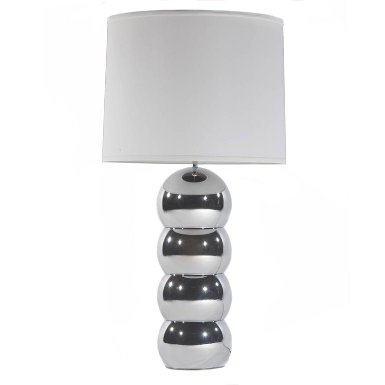 Pair of chrome stacked ball lamps by George Kovacs, circa 1970s. Classic design in great condition with new harps, linen shades and chrome finials. Takes one standard bulb; switch on neck. Overall 18.25