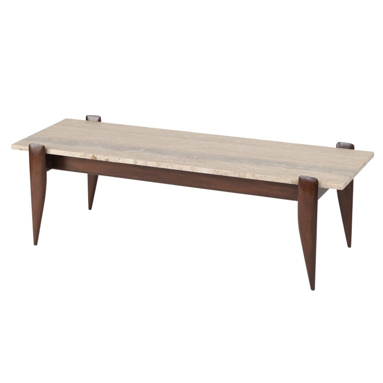 """This simple but elegant 1950s Gio Ponti coffee table has a warm-brown walnut frame with four sculpted and tapered legs that hold in place the 3/4""""-thick travertine top.   See this item in our Brooklyn showroom, 61 Greenpoint Ave., Suite 312,"""
