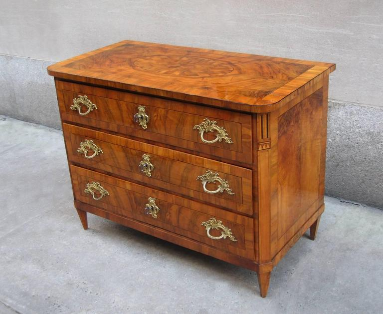 A fine Rococo three-drawer chest.
