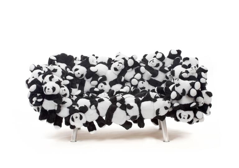 Plush sofa made from stuffed animals in a panda shape by Brazilian design duo and brothers Fernando and Humberto Campana.  The Campana Brothers, Fernando (b. 1961) and Humberto (b. 1953) were born in Brotas, a city outside of São Paulo. Together,