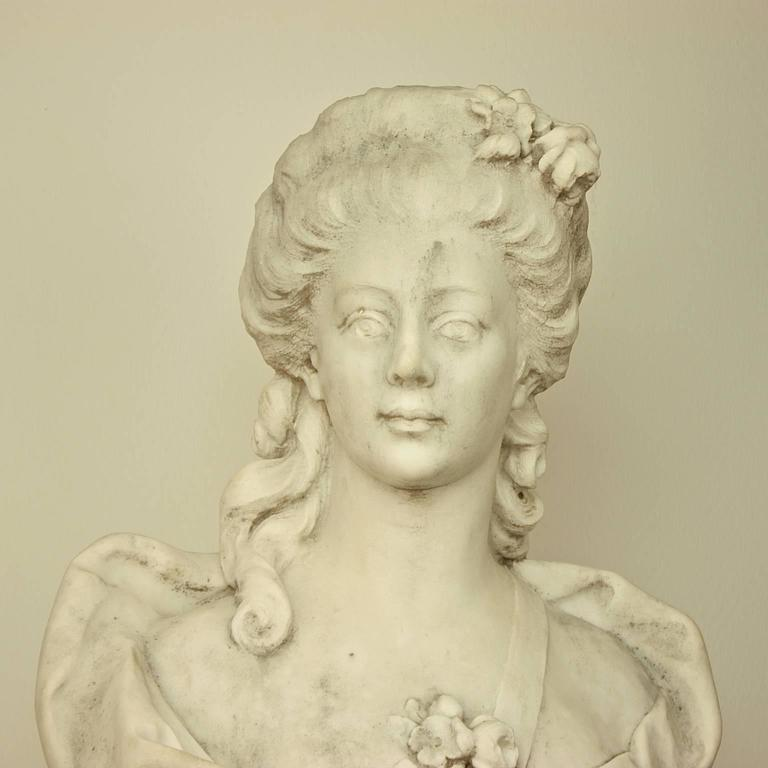 French white Carrara marble bust of a young lady in the style of the 18th century. A beautifully carved and sensual marble bust of a young woman who is 