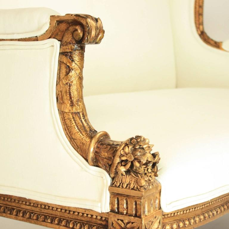 French 19th Century Louis XVI Style Wingback Giltwood Settee/ Sofa For Sale