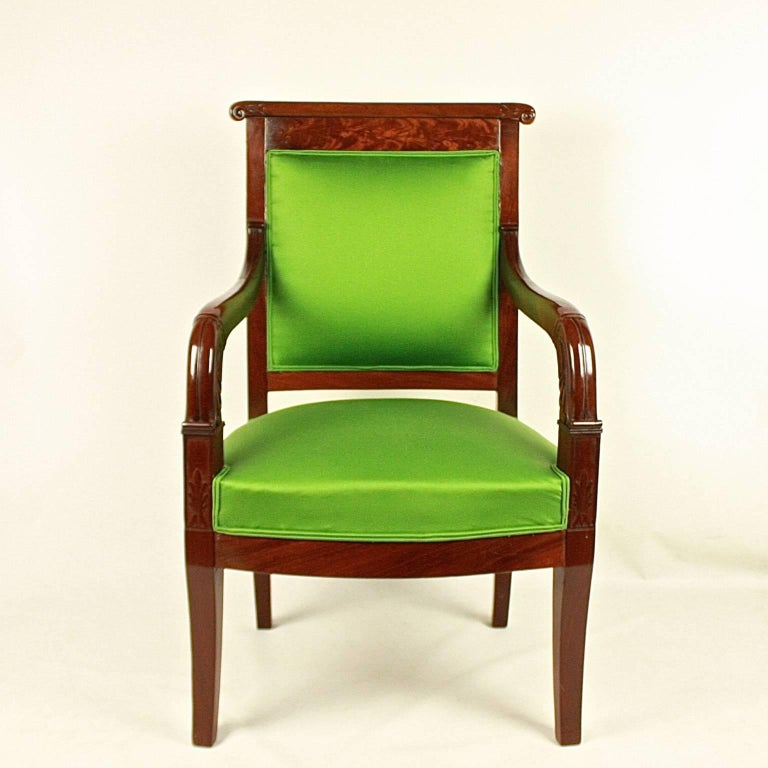 A pair of Empire mahogany fauteuils or armchair 'a la Reine' in the manner of Jacob-Desmalter/François-Honoré-Georges Jacob Desmalter (1770-1841, son of Jacob Desmalter), newly upholstered in fine green sateen from Manuel Canovas. A mahogany frame