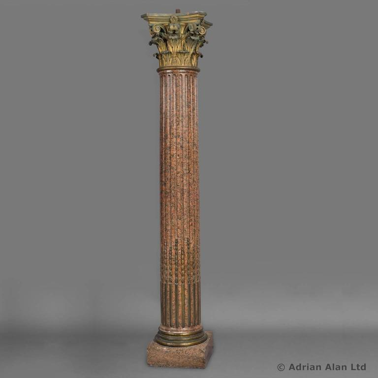 a set of three neoclassical style gilt bronze and rose granite corinthian columns after the model