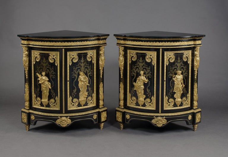 A fine pair of Louis XIV style gilt bronze mounted and boulle marquetry inlaid corner cabinets depicting the Four Seasons, in the manner of Andre-charles boulle, by Béfort Jeune.  French, circa 1870.   Stamped to the reverse of the bronze mounts