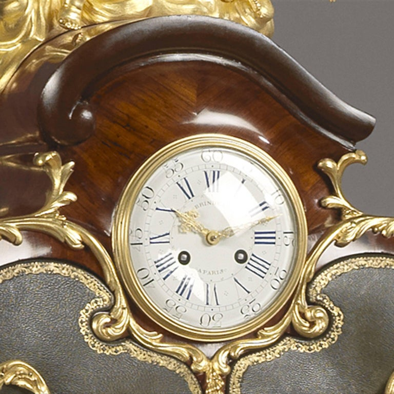 A highly unusual Louis XV style gilt bronze-mounted kingwood and marquetry writing desk and cartonnier.