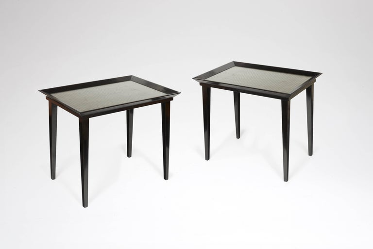 Pair of blackened wood tables, top sets with wired glass and palladium leaf.