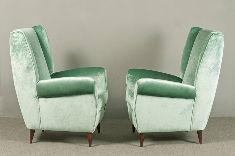 Elegant pair of Gio Ponti armchairs. Reupholstered in Velvet and silk.  Expertise archives.