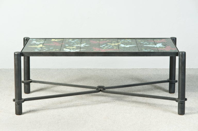 Famous glazed lava stones butterflies coffee table. iron base. Published in Jacques Adnet by Alain-Renè Hardy, Gaelle Millet.
