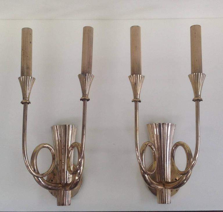 Wonderful and huge pair of brass sconces.