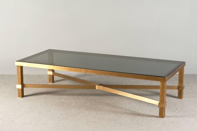 Awesome and sturdy rectangular coffee table, solid brass base and glass top.