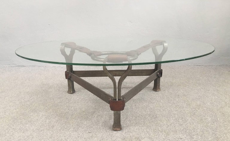 Iron and leather base with glass top coffee table attributed to Jacques Adnet.