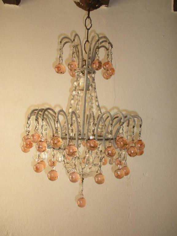 Housing 1 light.  Micro beaded loaded with crystal prisms, macaroni beads and Murano short bulbous balls.  Adding 5 inches of original chain and canopy.  Re-wired and ready to hang.  Free priority shipping from Italy.