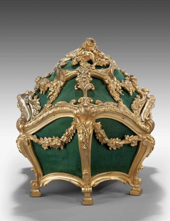 Very fine mid-19th century gilt bronze casket of complex Rococo form, decorated with foliage wreaths and flowers.