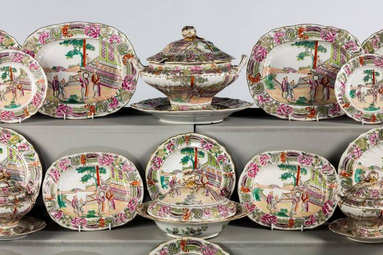 An unusual Staffordshire dinner service with very well shaped plates and dishes. The centres displaying series of different but complimentary garden scenes with Oriental figures. The borders very well painted with foliage, carrying fake Meissen